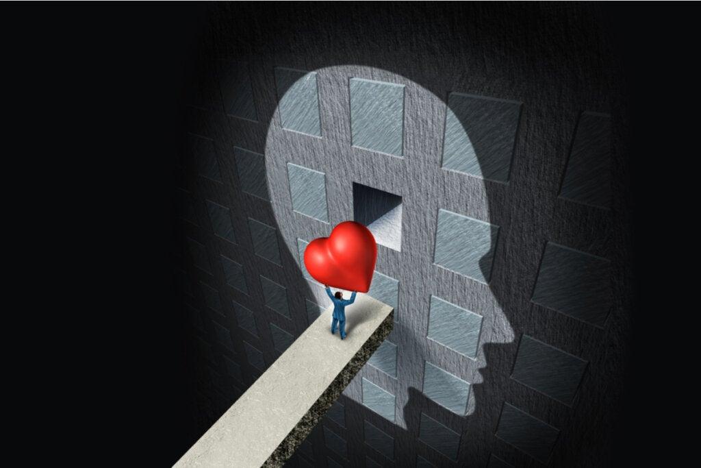 Persona entrando un corazón en la mente representando las emociones intensas